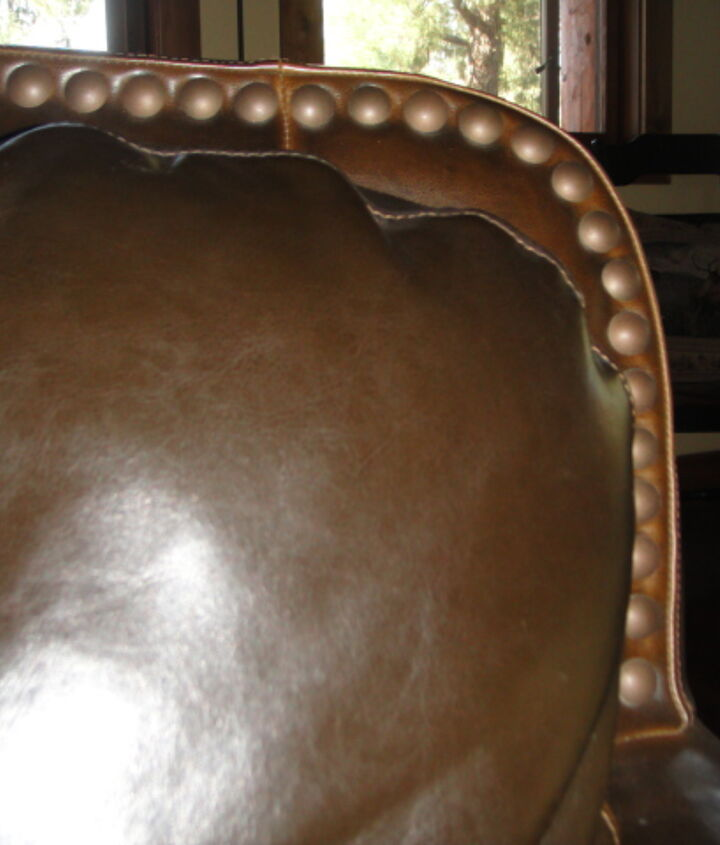 Leather Sofa, two chairs and two ottomans.
