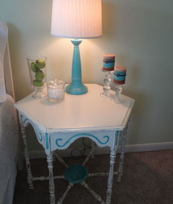 This six-sided table is the only piece of furniture I purchased while redoing the room.  It came from a local vintage shop and needed to be painted and distressed. Used a turquoise acrylic paint for lamps and this table.