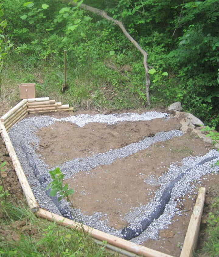 Then he dug a trench & installed the french drain (basically a pipe with holes in the top that collects water & channels it where you want it to go) & covered it with gravel.  Then he added a timber retaining wall.