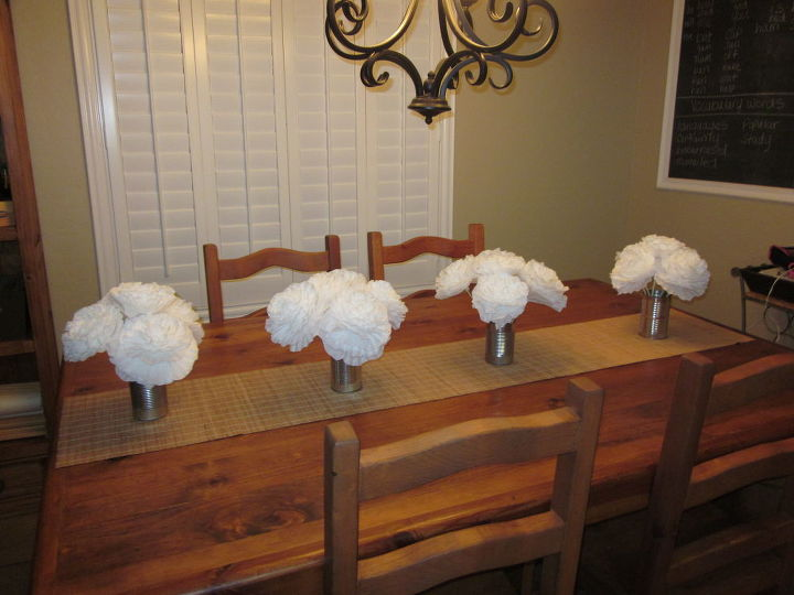 Large flowers made with coffee filters (8 Cup size) I attached them to a chopstick using hot glue. Used a total of 10 coffee filters per flower. Each pkg of coffee filters (200 count) makes 20 large flowers. Total cost $3.00
