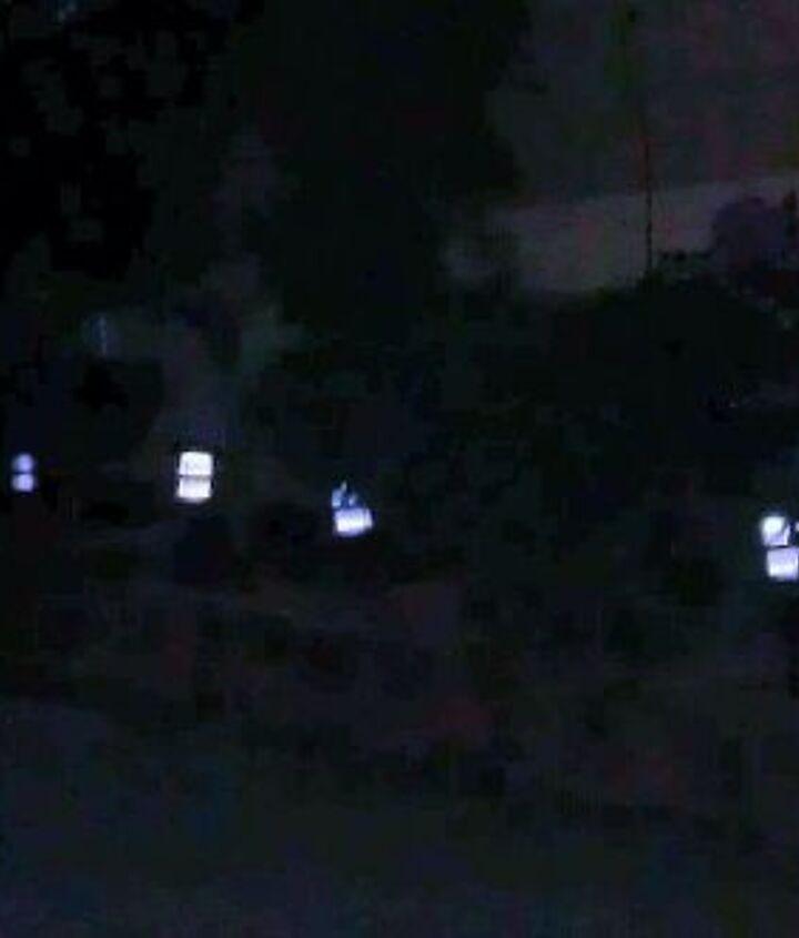 One row white solar lights around the house.