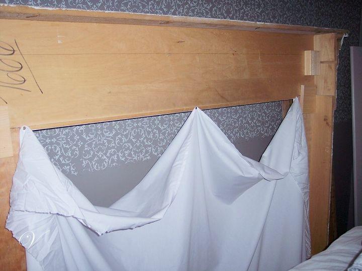 Draped with a twin flat sheet