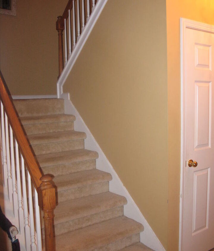 I want to put board and batten on right of these stairs not sure if I should go all the way up of half way.