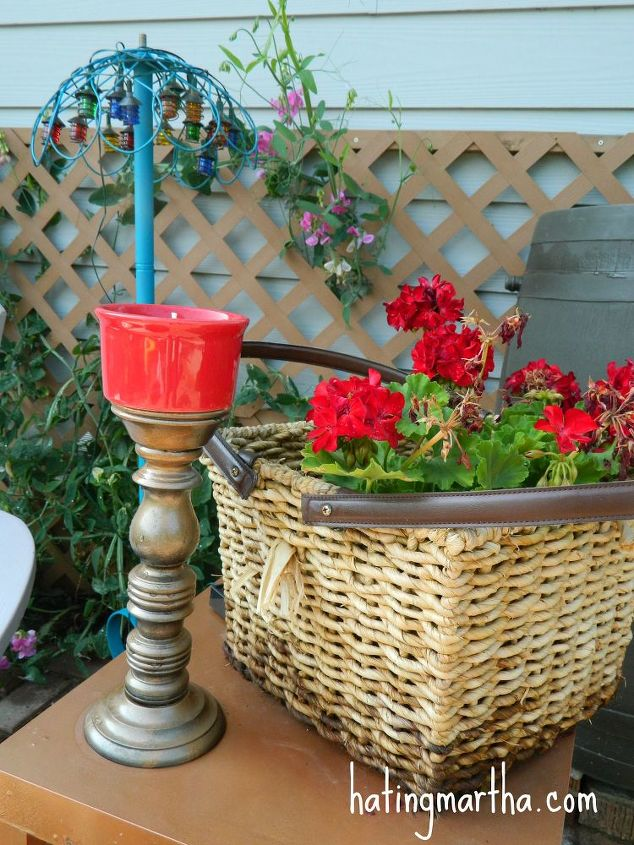 Take a floor lamp base, add a hanging flower basket (flipped upside down) and cover it with solar lights...outdoor lamp! A basket is sprayed with polyurethane to help it last in the outdoors.