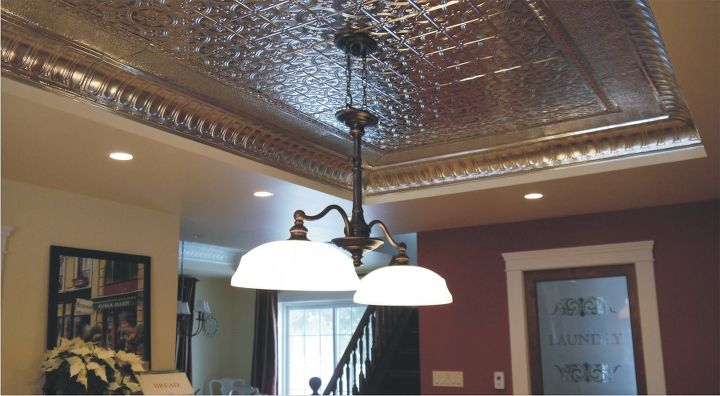 Natural tin ceiling and a new light fixture that I loved the style of but not the color (brass) so I painted it to match the cabinet hardware.
