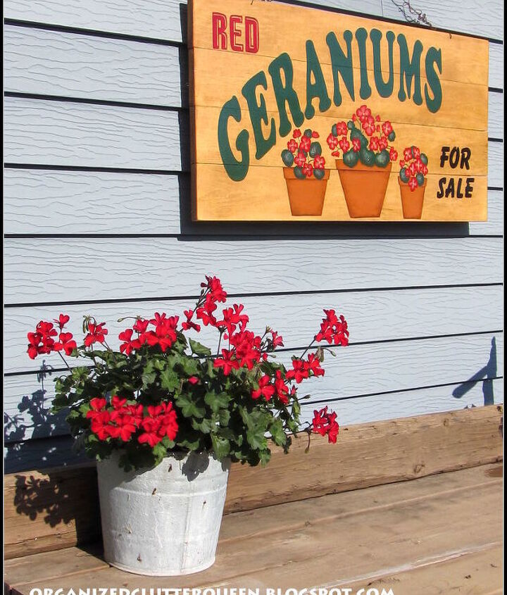 A sign painted by a friend and local merchant hangs over my potting bench.