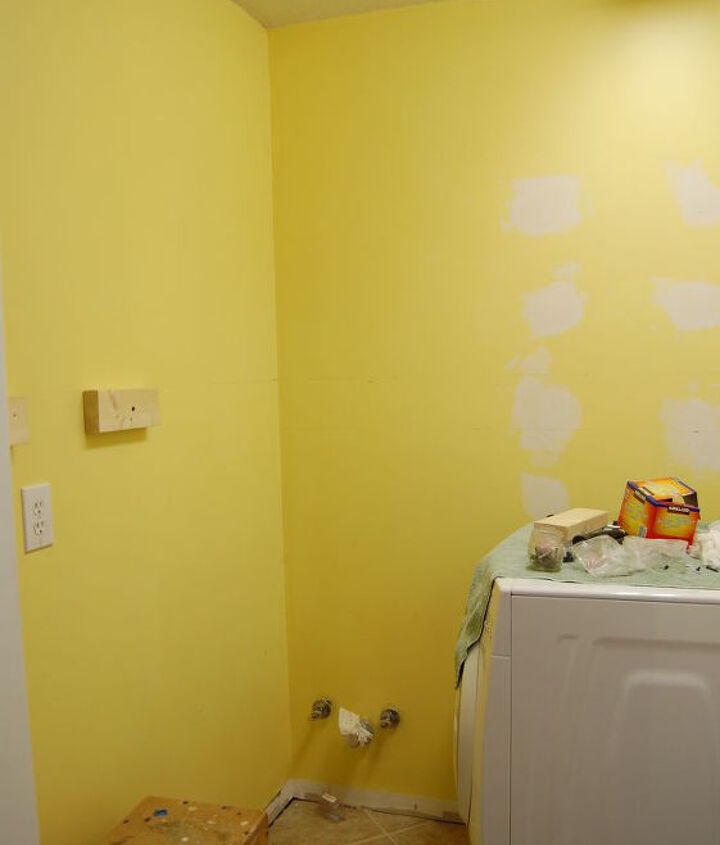 """Once painted a bright yellow, this color didn't really help to """"sunny-up"""" a space that actually needed a whole lot more."""