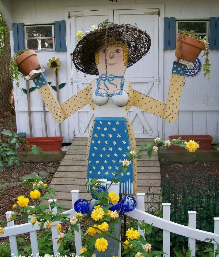 My Garden Lady ~ designed by me, built from scrap lumber by my Dad and painted by a dear friend. See more of my gardens and projects at http://ourfairfieldhomeandgarden.com or http://pinterest.com/barbrosen/our-fairfield-garden/