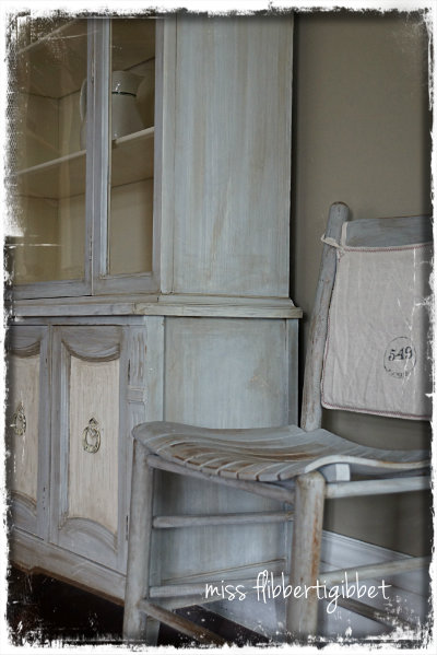 I also did a pair of farmhouse chairs to match. The little back covers are 100% linen with a hand stamped design.