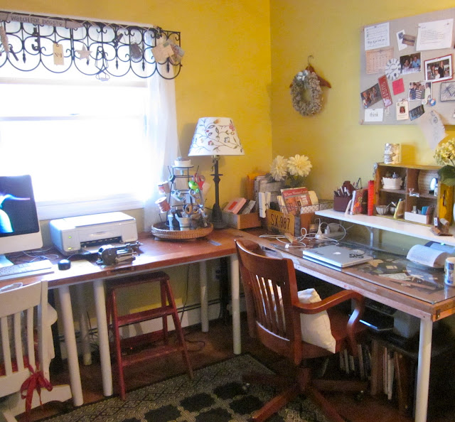 an ever changing creative space, craft rooms, doors, home decor, home office, shelving ideas, An L shaped desk made from IKEA tables and old doors One side has a glass top and the door panels are filled with treasures