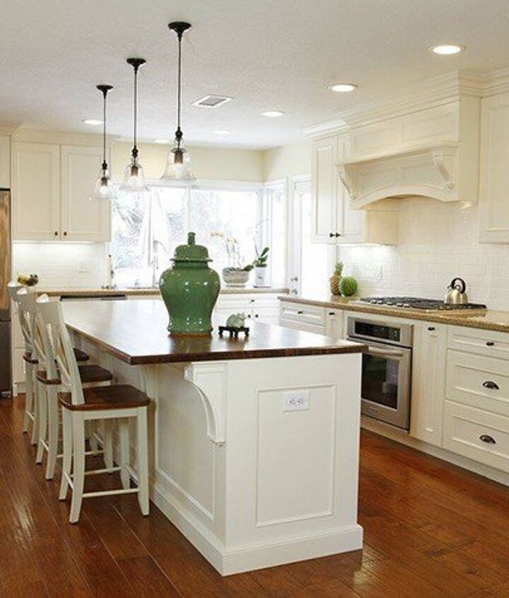 Courtesy of [url=http://www.hometalk.com/3710659/complete-kitchen-remodel-with-custom-cabinets-entertainment-center] A-Plus Interior Design[/url]