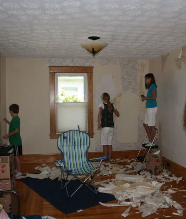 The kids ripping down the wallpaper.