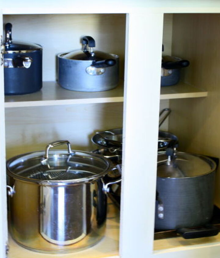 making a kitchen cabinet more functional, kitchen cabinets, shelving ideas, Before The cabinet was narrow and it was difficult to get pots pans in and out
