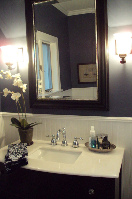 Marble topped vanity with oversized mirror.  Antique sterling bowl used as toiletry tray.  Ralph Lauren linens.