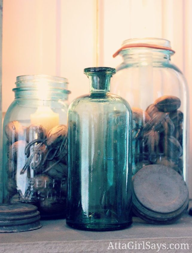 Vintage blue ball jars filled with pecans and candles