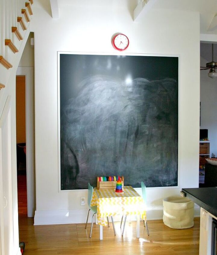 Paint a wall with chalkboard paint and then frame it with molding for a more finished look.