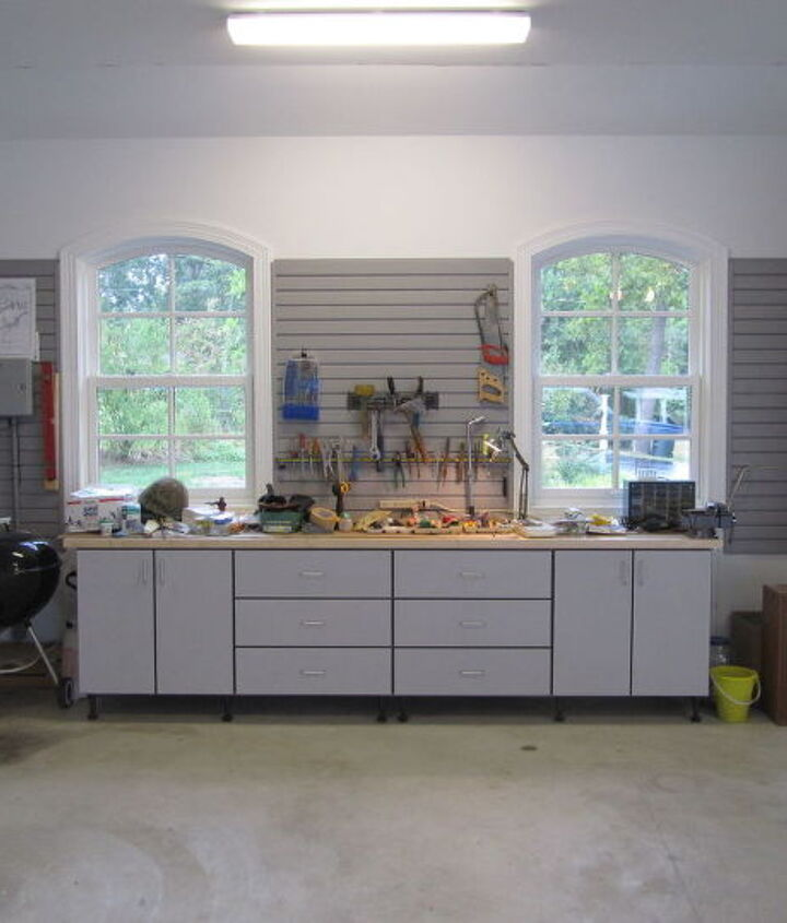 Dad's work bench includes a butcher block counter top and ample drawer storage.