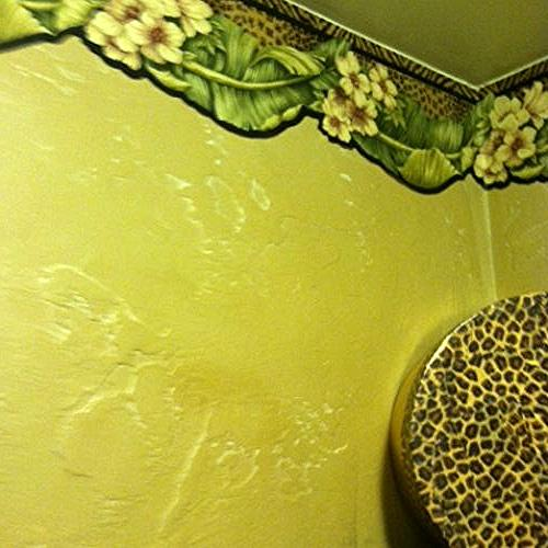 Border, yes, i know borders are going out of style but I loved this one with the animal print. I'm pretty much the only one that uses the powder room so I did it how I like it.  And believe it or not everyone loves it too.
