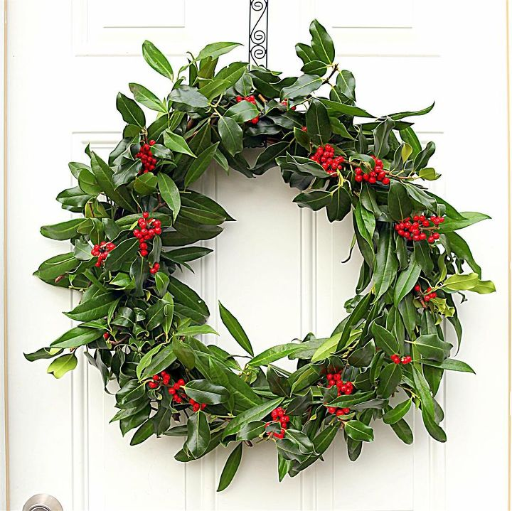 The holly and laurel branches that make up this wreath grow just outside my door. I don't think it needs a single thing added to make it look more festive.