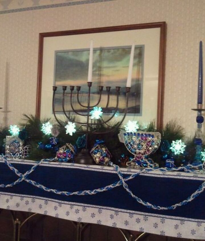 The family room mantelpiece keeps the Channukah spirit going.  For parties we light the huge menorah, and let the taper candles burn 8 hours.
