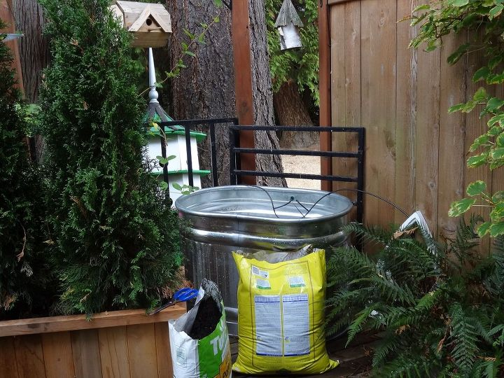 Brilliant idea!  These tanks are perfect for planters as they come with a built in drainage spout, are light weight and because they are galvanized - they never rust.