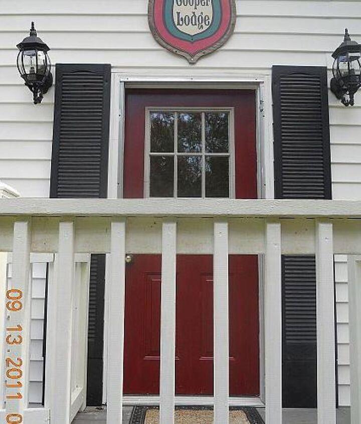 Paint the door a vivid color, I LOVE red doors!