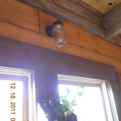 this was a 5 outdoor light i substituted the glass cover with a mason jar, home decor, lighting, mason jars