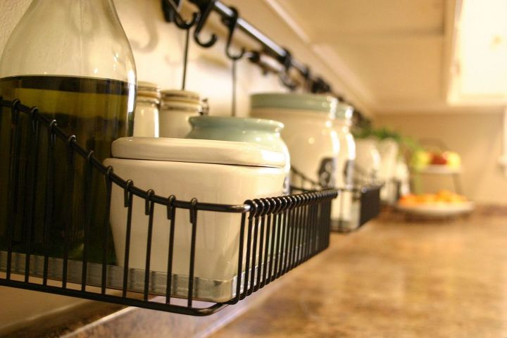 keeping the clutter off the counter, cleaning tips, kitchen design, Four baskets and two caddies for cooking items sugar and coffee tea cells phones and drying dishes