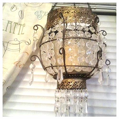 I LOVEthis candle chandelier! Paid $10 for it and it is awesome! fits perfectly in my scheme! Won't stay here but fits well here for now!