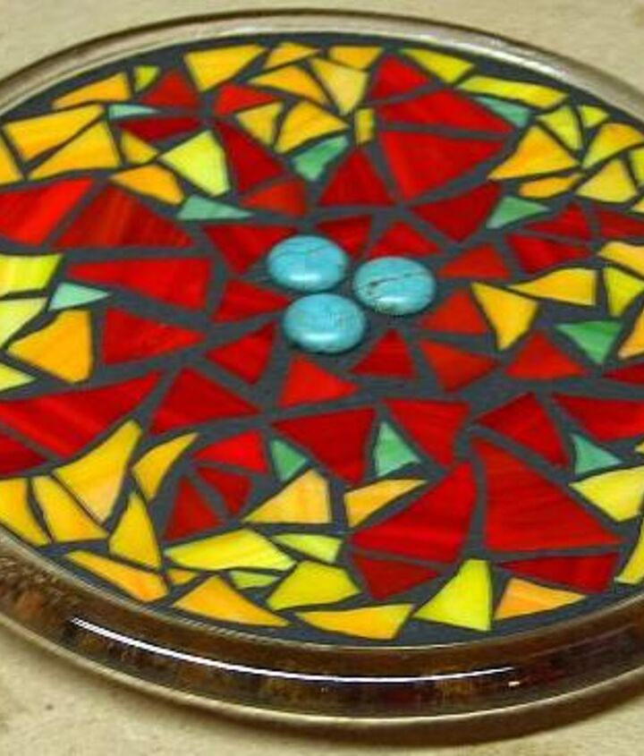 I have a friend that makes jewelry who gives me beads that she can't use (crooked holes, chipped, etc). They are great for mosaics. Here is an example with turquoise beads in the center of this trivet.