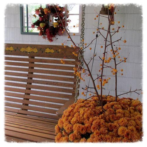Fall colors display on the porch.