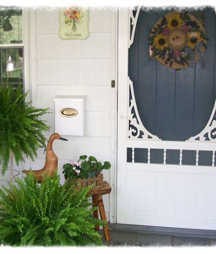 Late April porch 2012 with our vintage -look screen door from Home Depot.