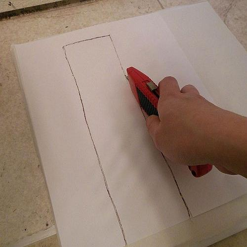 grouted vinyl tile, bathroom ideas, flooring, tile flooring, tiling, Iplaced the template on the tile and cut the tile with a utility knife Shallow cuts do the trick and then you can just pop the piece out