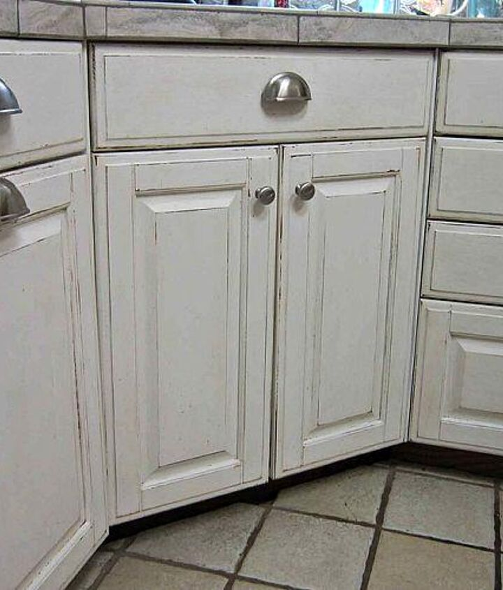 The first thing I did was paint and distress the cabinets.  They are quality cabinets so I didn't see the need to replace them.  I did however, purchase new hardware.