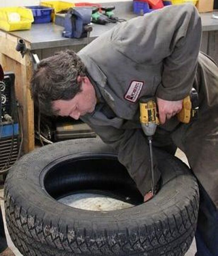 Step 3:  Securely fasten junk tire to base with long screws.