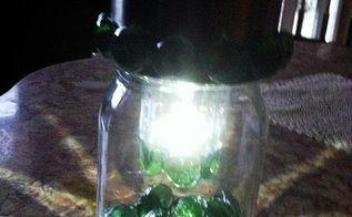 another solar light in a jar, crafts, lighting, This is after glued flat sided gems around the jar ring and around the little edge on the bottom of the clear part of the light This little part was where the cylinder and spike were to put the light into the ground