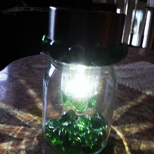 This is after glued flat sided gems around the jar ring and around the little edge on the bottom of the clear part of the light. This little part was where the cylinder and spike were to put the light into the ground.