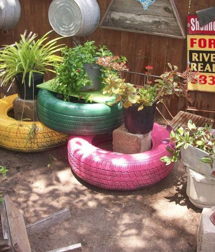 Spray painted old tires I had around the house to add some color to my back yard.