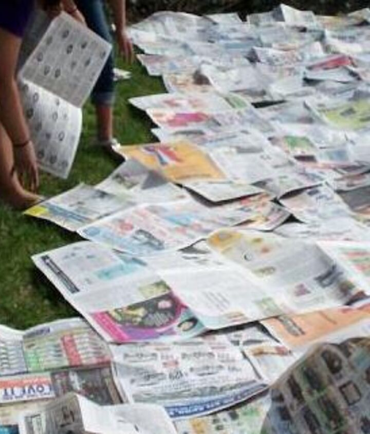 """First step was """"lasagna gardening""""- laying down newspaper on all of the grass"""