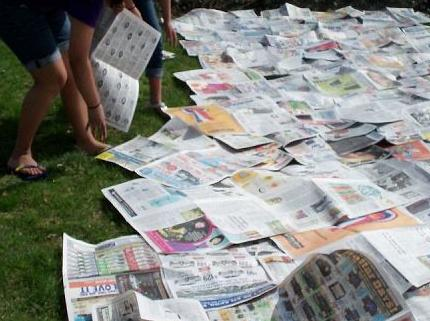 "First step was ""lasagna gardening""- laying down newspaper on all of the grass"
