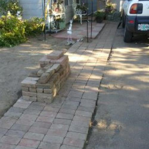 Brick work to the paver work by front door (someday a porch! I want a porch!)