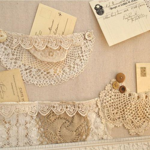 a shabby bulletin board with pockets made of lace and doily s, crafts