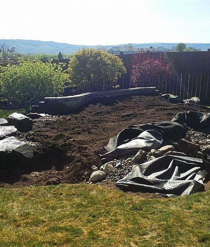 Retaining Wall, 12 CY of topsoil, liner, basin, retaining wall and retention boulders placed