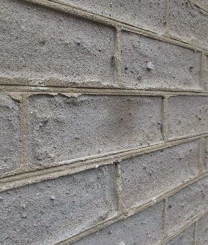 extreme close up of the brick - now eroded further behind the mortar levels.