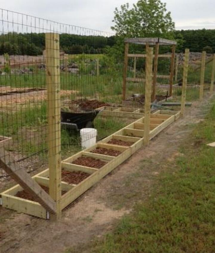 Tomato beds getting ready to be planted.  Also shows our revamped garden fence to keep deer and rabbits out