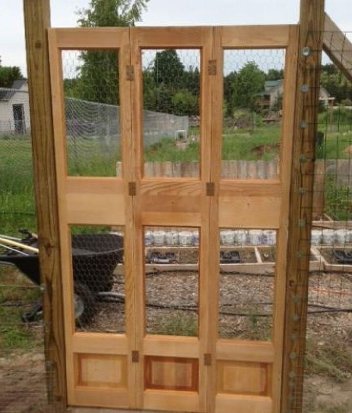 DIY Garden Gate made from solid wood bi-fold closet doors and chicken wire.