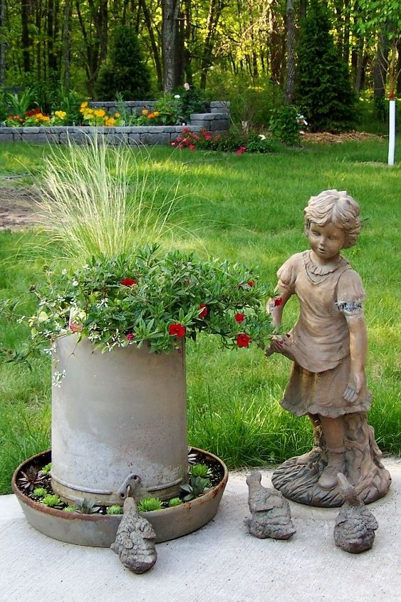 gardening ideas, gardening, Added a planter made from a vintage chicken feeder this year It goes well with my little girl feeding the ducklings