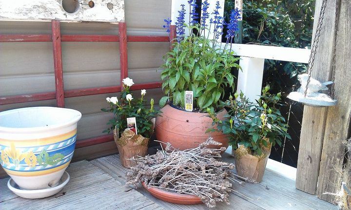 The ugly black metal panels behind this table are now gone.