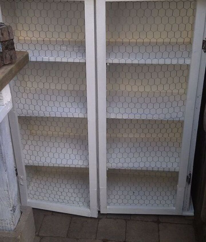 This is the cabinet after. New doors were created from leftover 2x2s. I didn't have 2x2s long enough so I joined pieces together which you can see at the bottom. I didn't care that it didn't look perfect. I wanted a vintage look.
