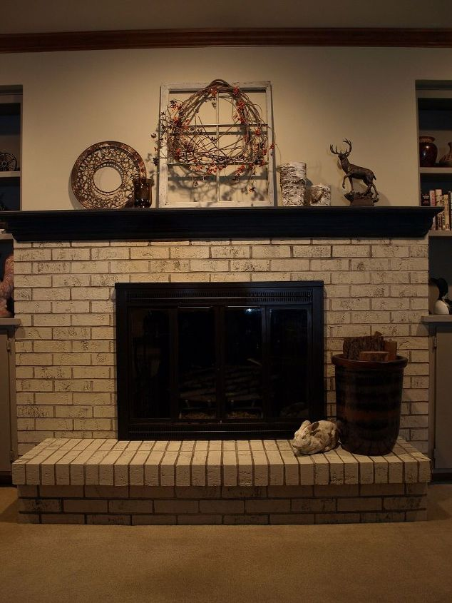 The fireplace is bright, clean and modern. The mantel painted in Graphite Chalk Paint® really makes a bold statement. We painted the metal surround with Rust-oleum High Heat Paint.